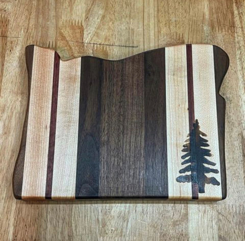 State of Oregon shaped cutting board made with Forest 2 Home hard Maple and Walnut wood featuring wood brand pyrography design