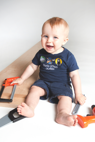 Child woodworker pictured with premium hardwood lumber and faux plastic hand tools