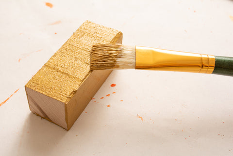 Gold paint being applied to Forest 2 Home premium hardwood lumber scrap wood woodworking DIY project