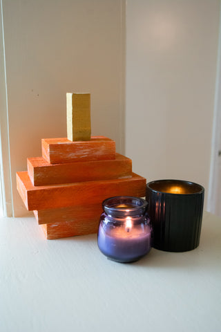 DIY painted wooden pumpkin interior decoration. DIY home craft with candles