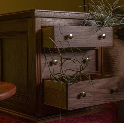 Woodworker constructed Walnut set of drawers in woodwork shop. Custom furniture built with Forest 2 Home premium hardwood species  Walnut