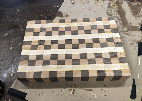 Cutting board made of different lumber species including Walnut, Hard Maple and Cherry Wood