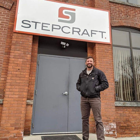 Forest 2 Home shopf2h community member and veteran woodworker, Mike, standing in front of Stepcraft CNC machine facility