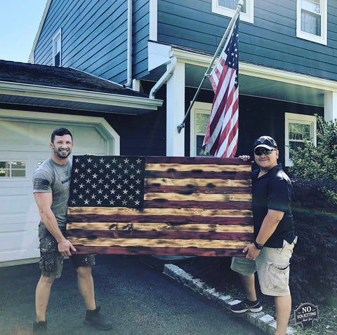 Wooden American Flag Build made by woodworker in wood shop. Wood flag features pyrography