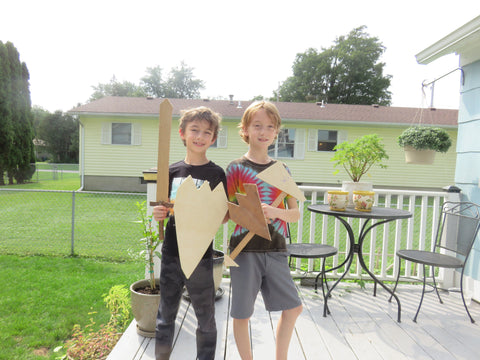 Two children woodworking with Forest 2 Home premium hardwood lumber