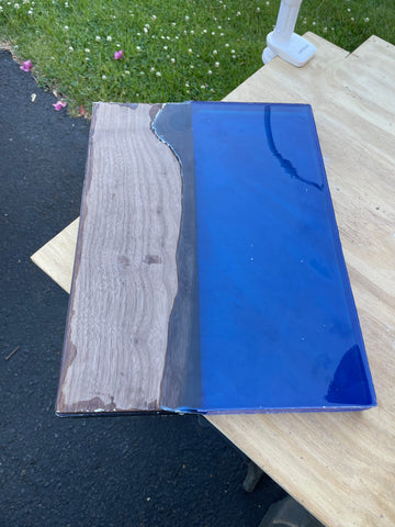 F2H shop premium quality Walnut hardwood with blue epoxy resin pour. DIY Walnut wood and epoxy resin table top before planing, sanding and finishing in woodworking workshop