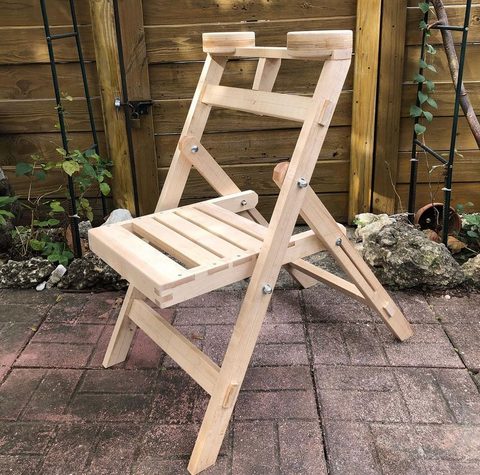 DIY Hard Maple lumber folding chair crafted in workshop by woodworker. Custom build household furniture from premium Hard Maple lumber
