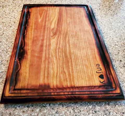 Premium quality hardwood charcuterie board and cutting board made Forest 2 Home lumber featuring pyrography design work and wood carving