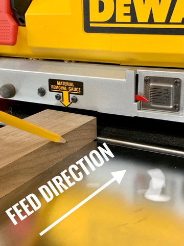 Woodworker in a workshop explains planing feed directions woodworking tip