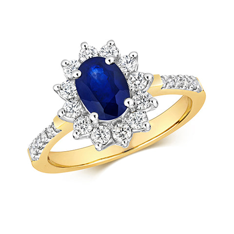 9CT Yellow Gold ring with a white gold wetting. Set with Oval Sapphire in a Cluster of round Diamonds which are set in a claw setting plus Diamonds set in the shoulders.