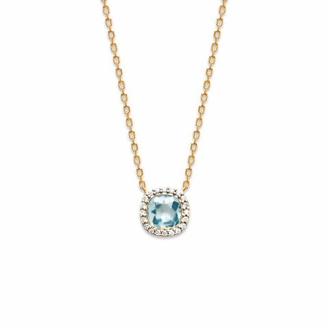 Our Cushion Me necklace is 18k gold plate with an aqua cushion shaped stone feature, surrounded by a beautiful cluster of cubic zirconia.