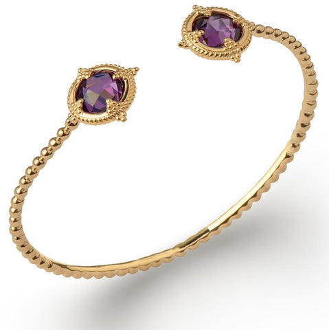 This bangle is the perfect fashion accessory for any lady! They flatter anyone, with the beautiful round cut amethyst colour stones embedded in 18 Karat, gold plated bangle. It will be hard for people not to recognize, showering its wearer with more confidence and pride.
