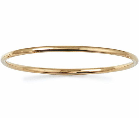 This solid round cut slave bangle is a must for any jewellery collection because it's so easy to accessorise with whatever you are wearing.  The 'Slave to Love' 18k gold plated bangle is great for a self purchase or gift and can be layered up with other bangles for a stacking affect