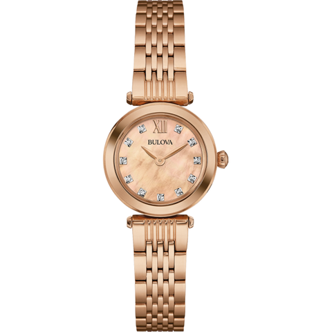Gorgeously attractive ladies watch is added to the Diamonds range by Bulova. A pink mother of pearl analogue display sparkles with cute diamond stud hour markers. Slender rose gold dials are powered by quartz and made to gleam under mineral crystal glass. A beautiful rose gold stainless steel bracelet strap, complete with deployment clasp, finishes the watch perfectly.