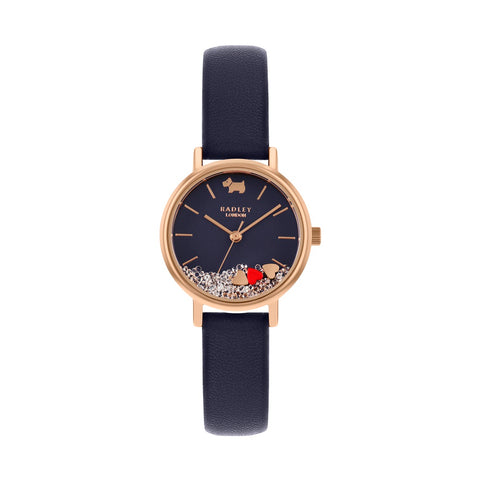 Radley Round Rose Gold Plated case which has a navy face with floating stones and hearts plus navy leather strap.