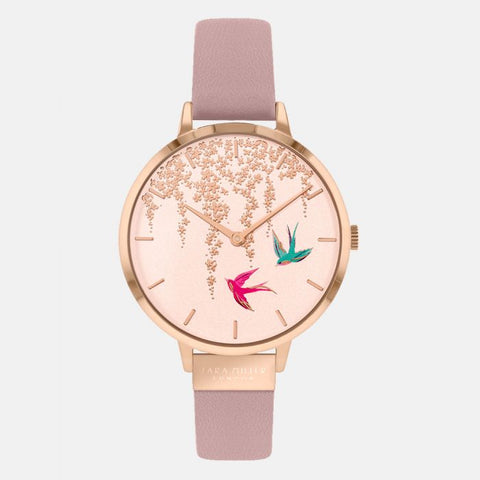 This Swallow Rose Gold Pink Watch has a rose gold plated case with a pink genuine leather strap.