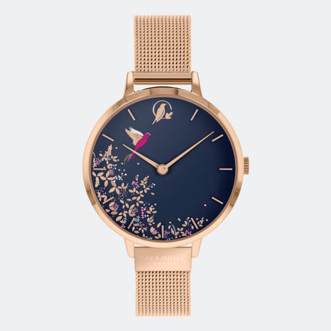 This Navy Hummingbird watch has a rose gold plated case with an adjustable rose gold mesh strap.