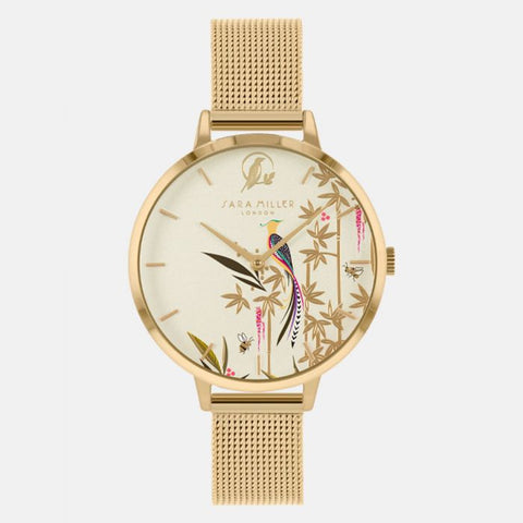 This delicate design has a gold-plated case with an adjustable gold mesh strap.