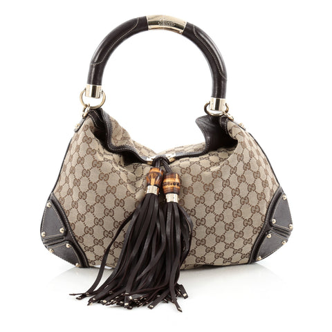 22f8be24972 Buy Gucci Indy Hobo GG Canvas Medium Brown 1450701 – Rebag