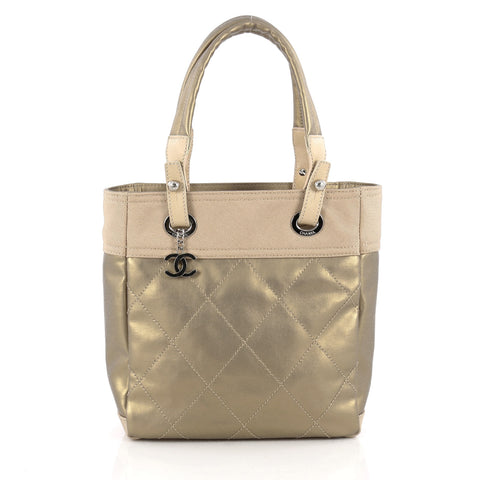a12c28abe317 Buy Chanel Biarritz Tote Quilted Coated Canvas Small Gold 1682703 – Rebag