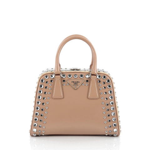 aa9d74add942 Buy Prada Pyramid Top Handle Bag Studded Vernice Saffiano 1707401 – Rebag