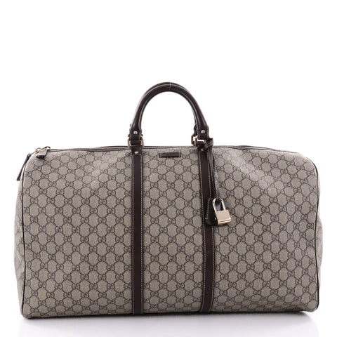 1c601ca7aff Buy Gucci Carry On Convertible Duffle Bag GG Coated Canvas 2421902 – Rebag
