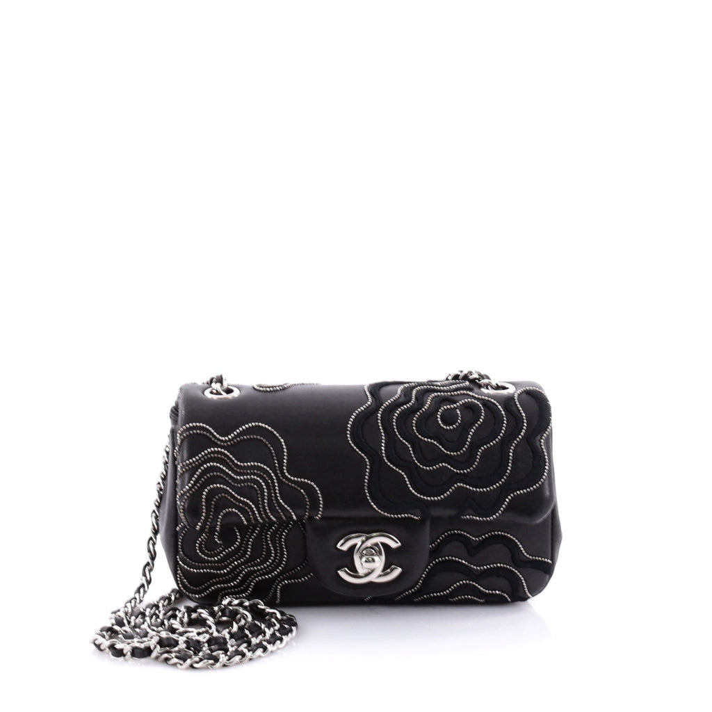 a4fa48988851 The camellia is one of the most frequently recurring emblems in Chanel's  designs along with its signature CC logo. Although it is a strong icon for  this ...