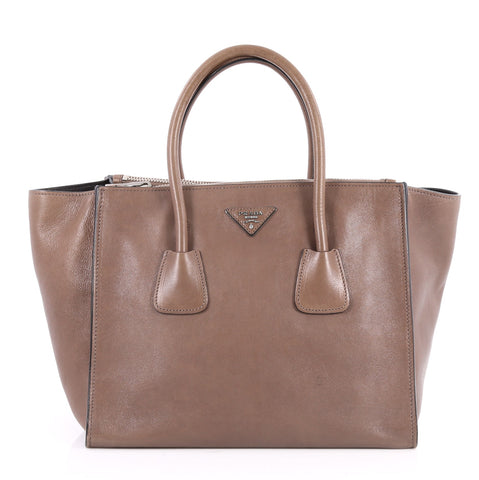 dbf62b6ae7eb68 Buy Prada Twin Pocket Tote Glace Calf Small Brown 2603501 – Rebag