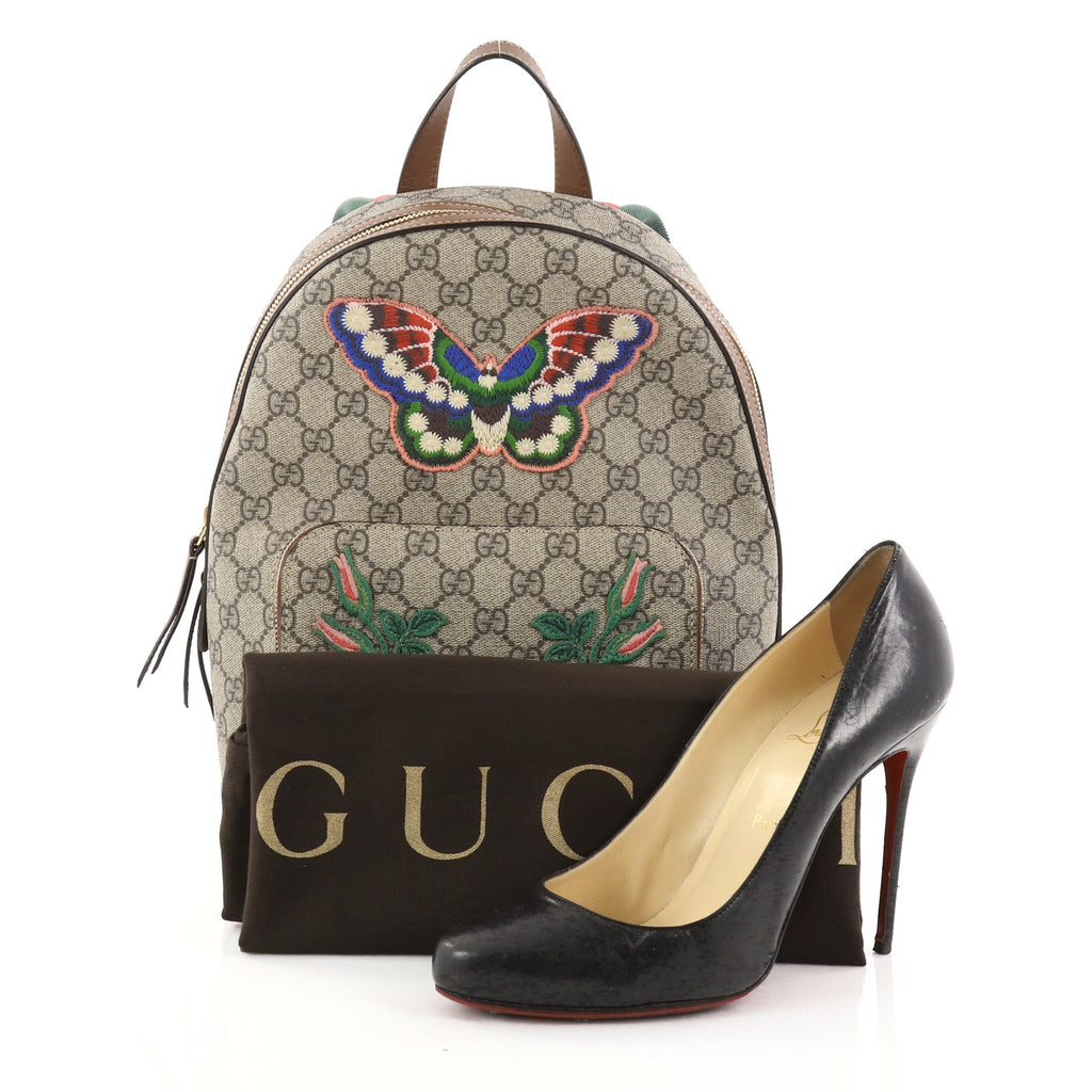 5e37e312df23 Buy Gucci Zip Pocket Backpack Embroidered GG Coated Canvas 2766702 ...