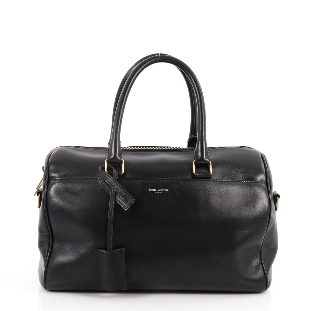 3a9f7b30f26d Buy Saint Laurent Classic Duffle Bag Leather 12 Black 3019703 – Rebag