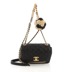 Chanel Model: Two Tone Camellia Flap Bag Quilted Sheepskin Extra Mini Black 37907/1