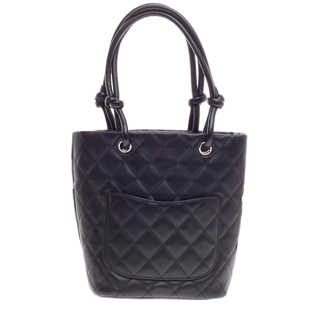 c07ec2e9cabea9 Buy Chanel Cambon Tote Quilted Leather Petite Black 330808 – Rebag