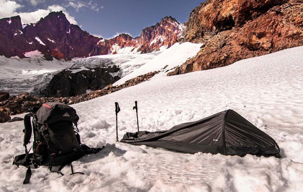 bivy sack setup in snow with trekking poles