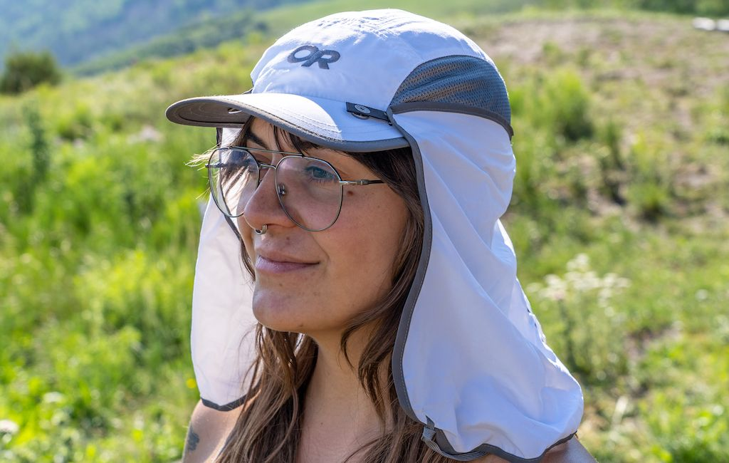 woman hiker wearing a caped OR hiking hat