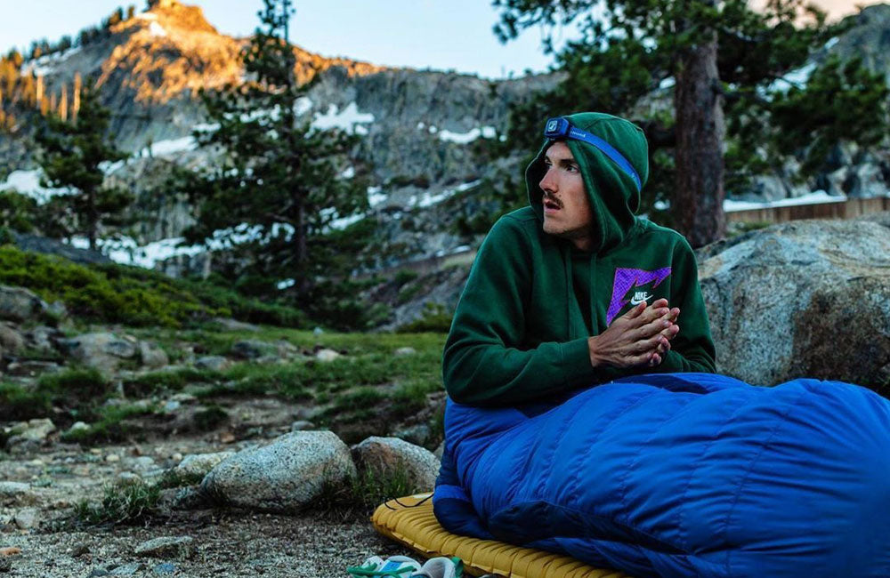 sleeping bag outside hiker