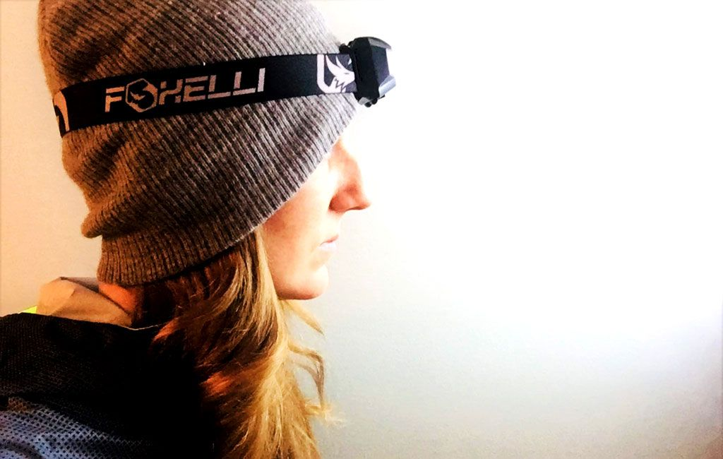 Foxelli rechargeable headlamp on woman's head