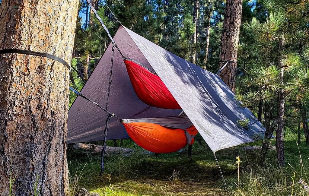 hammock camping with tarp