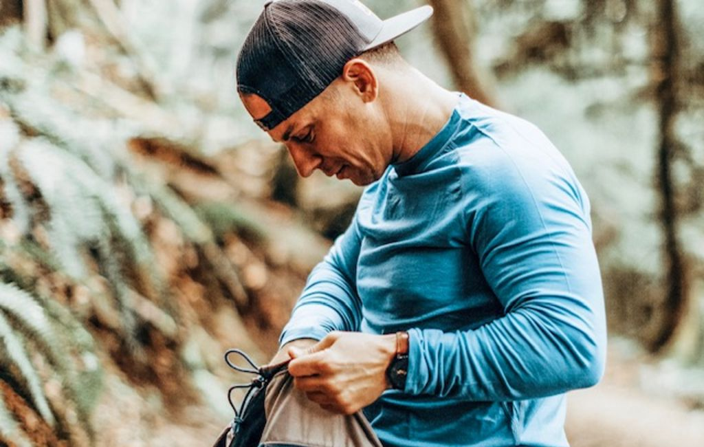 backpacker wearing a blue merino wool baselayer