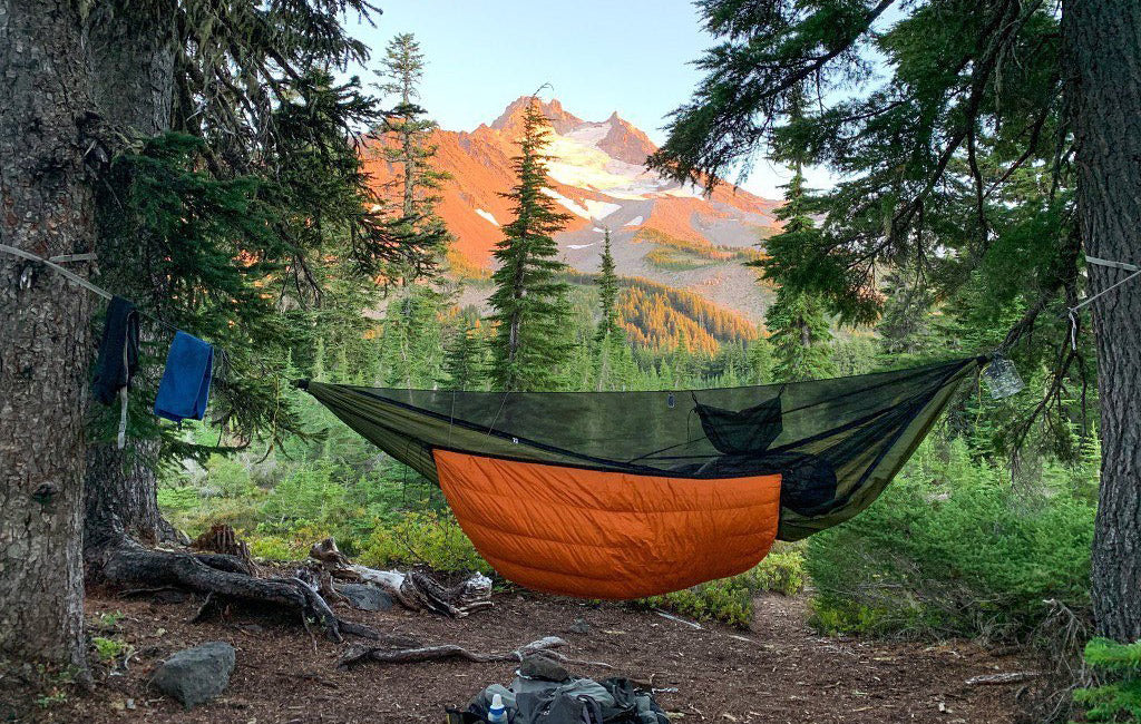 full hammock camping setup with underquilt and bug net