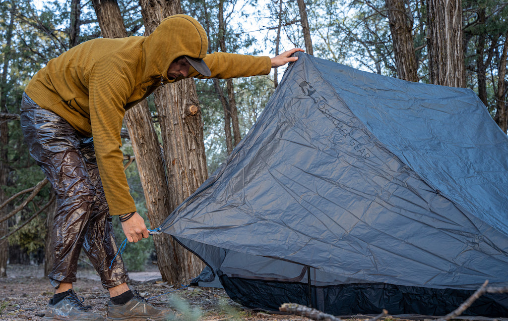 pitching a tent in rain pants