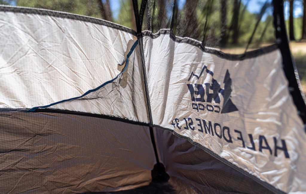 Tent poles holding a 3-person freestanding tent