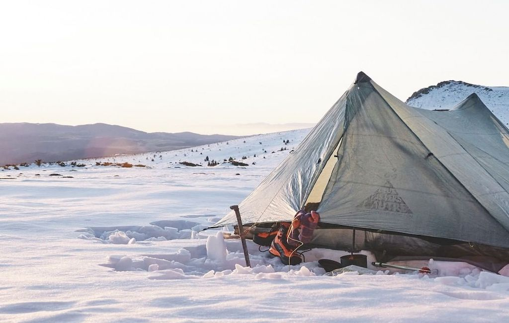 winter hiking tent in snow