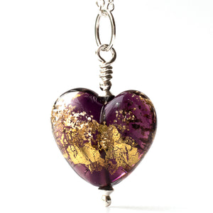 Purple glass heart burnished with gold foil