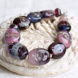 Purple art glass bead bracelet
