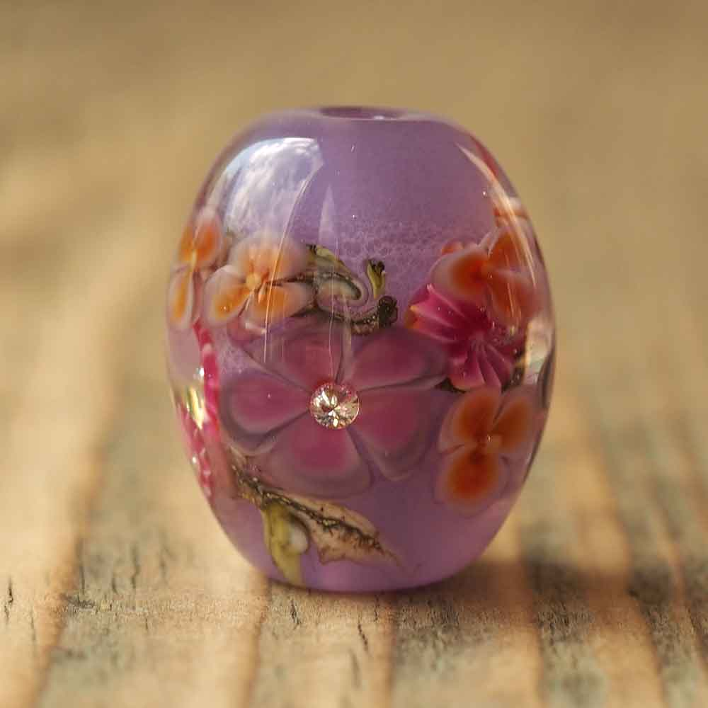 purple floral lampwork bead with cubic zirconia