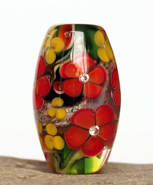 Green lampwork glass bead with bright red flowers and cubic zirconia