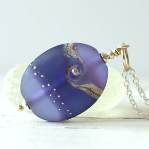 Purple frosted lampwork glass pendant with cubic zirconia
