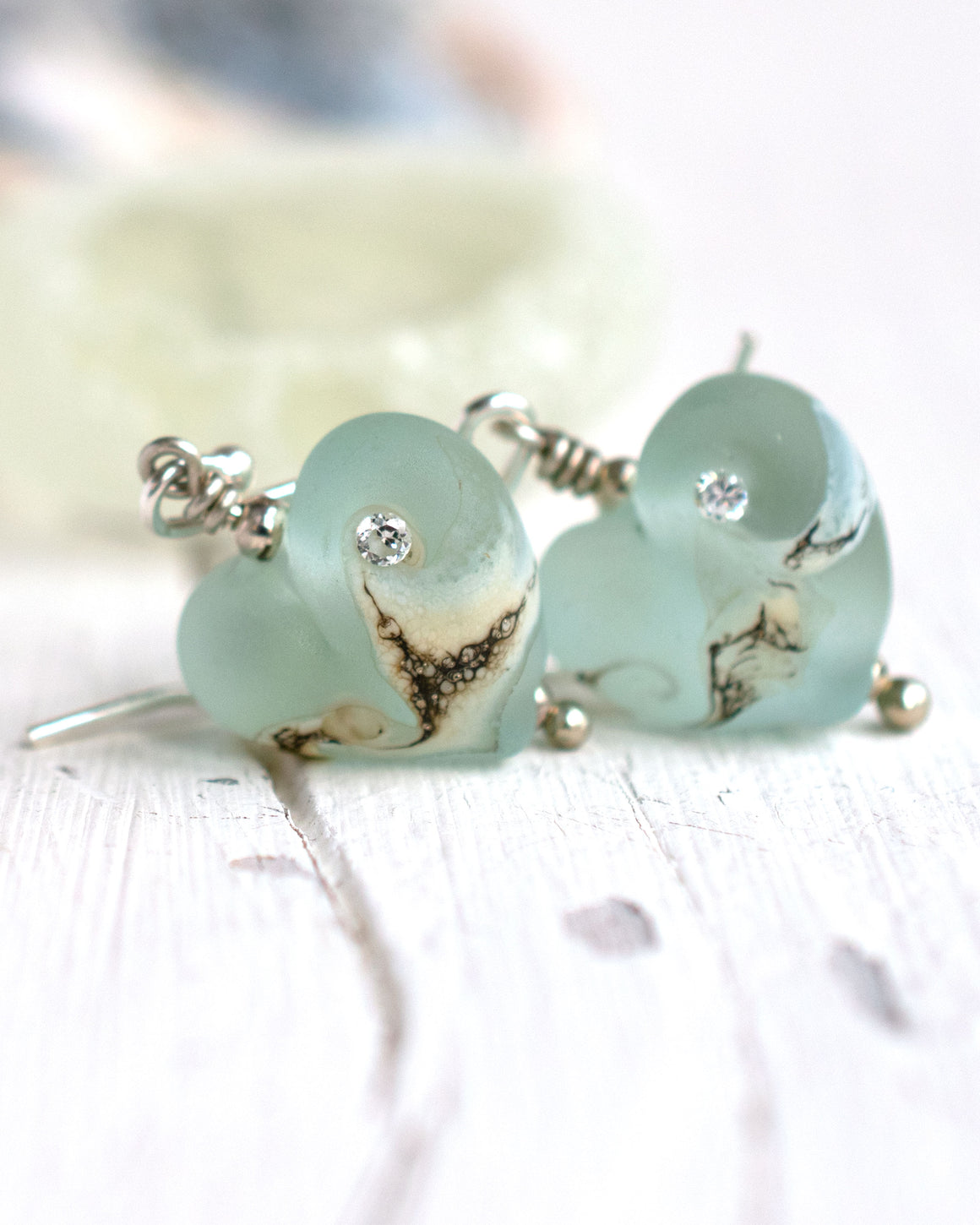 small aqua blue art glass bead heart earrings with cubic zirconia