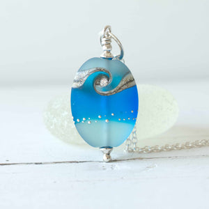 Aquamarine frosted lampwork glass pendant with cubic zirconia
