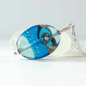 aquamarine blue shiny lampwork glass pendant with cubic zirconia